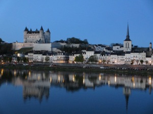 Pretty Saumur in the Loire Valley, France.  Staying outside the large cities will also save you money