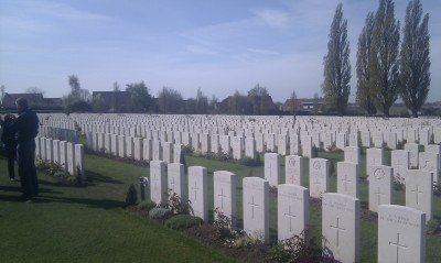Simple white headstones of Commonwealth war dead.  White is not always a cheery colour