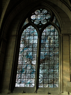 A 1960s window, designed by a local Reims artisan, depicting water