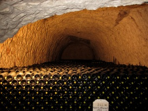 Thousands of bottles deep in the caves at Taittinger