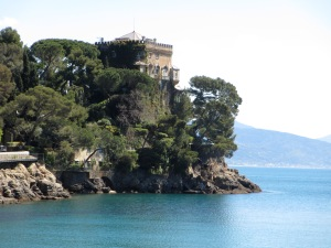 Italian villa perched on a cliff overlooking the water