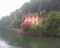 water from Lake Como with an Italian villa in the background
