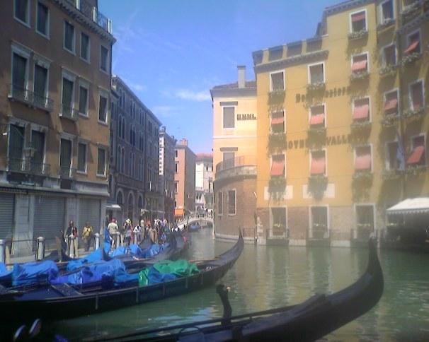 gondolas on a canel in Venice