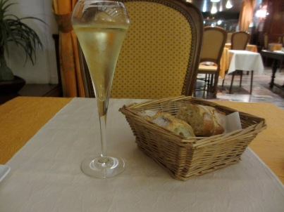 glass of sparkling wine and basket of bread, travel, travel tips, travel planning