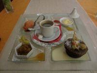 travel, travel tips, travel planning, french cafe gourmand with four different desserts and a cup of coffee