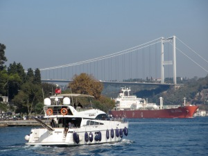 travel, travel tips, travel planning, a container ship, yacht on the Bosphorus, with the bridge to the Asian side of Istanbul in the background
