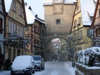 snow covered medieval gateway in Rothenburg, Germany
