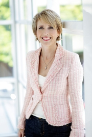 Andrea Powis dressed in pink jacket