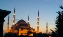 mosque at dusk with 5 minarets