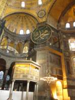detailed interior of Hagia Sophia with Islamic scripture, pulpit, lights and fresco paintings