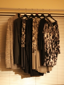 rack of long sleeved tee shirts hanging on a rail