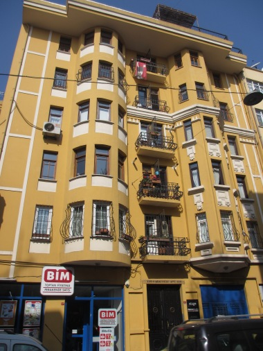 yellow building with bay windows