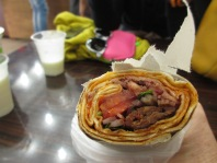rolls of flat bread with meat and vegetables inside