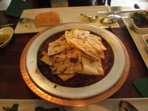 plate with sauce and flat bread