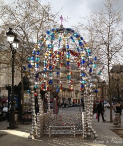 glass arch over a seat in a square in Paris