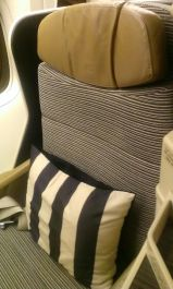 Etihad business class long haul seat with black and white striped pillow