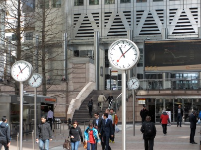 Multiple round clocks on poles in Canary Wharf