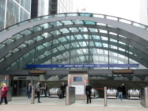 metal arches at Canary Wharf Underground Station with escalators