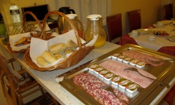 plate of cold meats and cheeses, white toaster