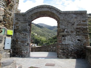 stone archway with hills in the background