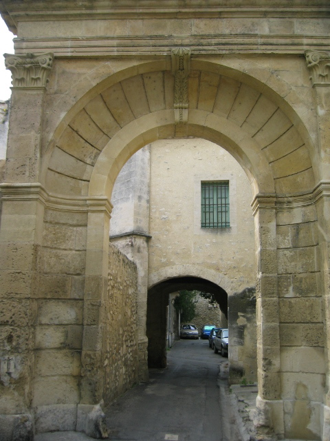 two stone archways on a backlane