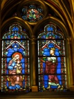Stained glass window of a man and woman Ste Chapelle Paris