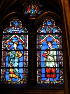 stained glass window in Saint Chapelle Paris ofa man and a woman