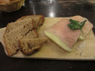 wooden platter of foie gras and toast