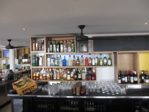bar with shelves with bottles of alcoholic drinks
