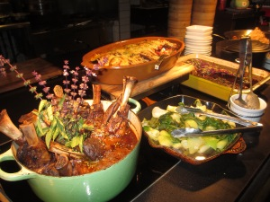 plates of hot food on a buffet