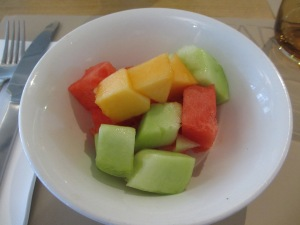 white bowl of fresh fruit salad