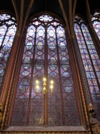 Stained glass window and chandelier at Ste Chapelle