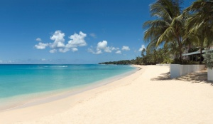 white sandy beach and blue water at Bora Bora