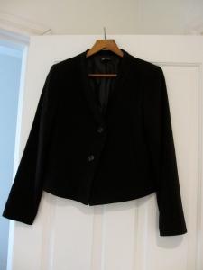 cropped black jacket on a hanger