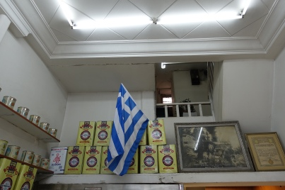 Greek flag and cheese tins on a shelf