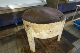 round wooden butcher's block in the Athens meat market
