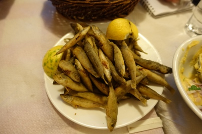 Greek whole fried fish on a plate