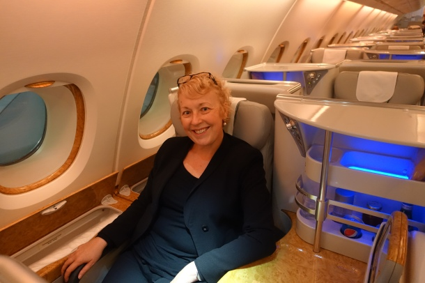 woman sitting in Emirates Business Class A380