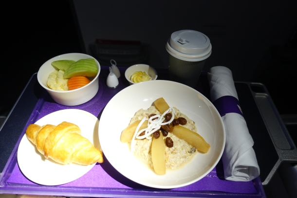 Burcher muesli, croissant and fruit served for breakfast on Virgin Australia Business Class