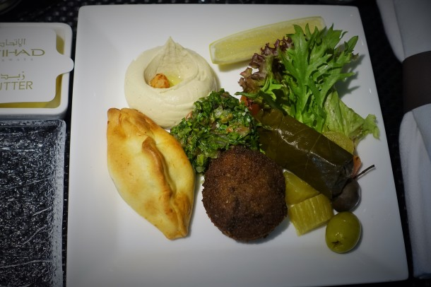 mezze plate with salad, hummous, pastry and falafel on Etihad Airways