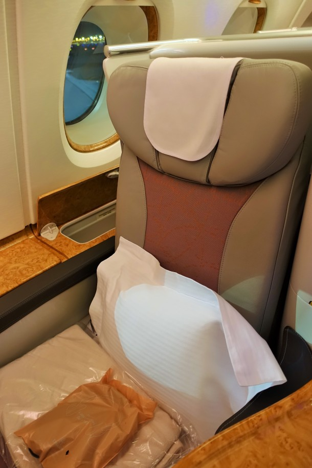 Business Class seat on Emirates A380 Business Class with white pillow